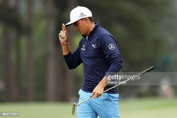 Rickie Fowler of the United States acknowledges the crowd on the eighth hole during the third round of the 2018 Masters Tournament at Augusta...