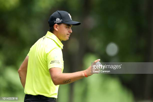 Rickie Fowler of the United States acknowledges the crowds after completing his first round of the 100th PGA Championship at the Bellerive Country...
