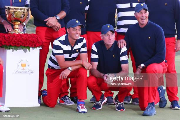 Rickie Fowler of the United States along with Jim Furyk and Matt Kuchar of the United States during the Trophy Presentation at the Presidents Cup on...