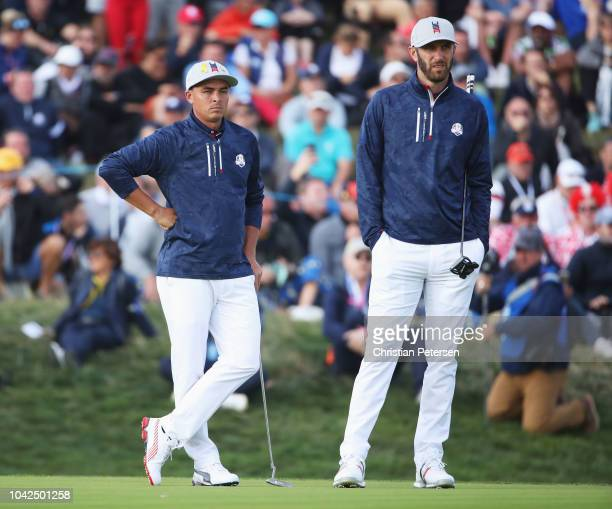 Rickie Fowler of the United States and Dustin Johnson of the United States during the afternoon foursome matches of the 2018 Ryder Cup at Le Golf...