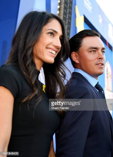 Rickie Fowler of the United States and fiance Allison Stokke depart the opening ceremony for the 2018 Ryder Cup at Le Golf National on September 27...
