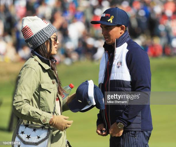 Rickie Fowler of the United States and fiance Allison Stokke during the morning fourball matches of the 2018 Ryder Cup at Le Golf National on...
