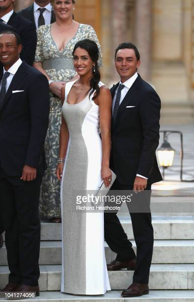 Rickie Fowler of the United States and fiance Allison Stokke pose with Team United States before the Ryder Cup gala dinner at the Palace of...