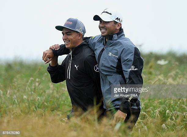 Rickie Fowler of the United States and Jason Day of Australia walk down the 3rd hole during the second round on day two of the 145th Open...