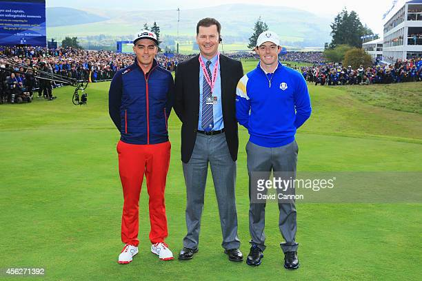 Rickie Fowler of the United States and Rory McIlroy of Europe pose on the 1st tee with referee David Rickman during the Singles Matches of the 2014...