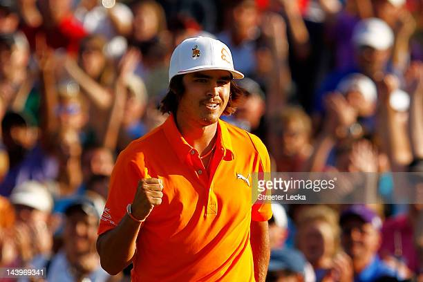 Rickie Fowler of the United States celebrates after making a putt for birdie on the first playoff hole to defeat Rory McIlroy of Northern Ireland and...