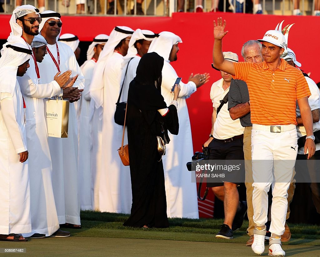Rickie Fowler of the United States celebrates after winning in the final of the Abu Dhabi Golf Championship in the capital of the United Arab Emirates on January 24, 2016. Fowler opened up a two-shot lead following a 65 in his third round that was eventually completed in the morning, and then shot a three-under par 69 for a 16-under par total. / AFP / KARIM
