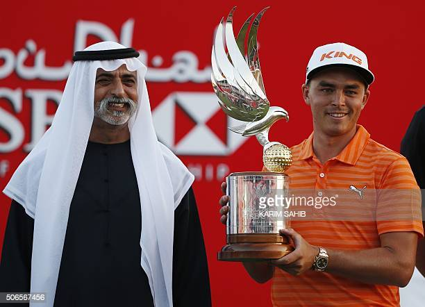 Rickie Fowler of the United States celebrates with his trophy after winning in the final of the Abu Dhabi Golf Championship in the capital of the...
