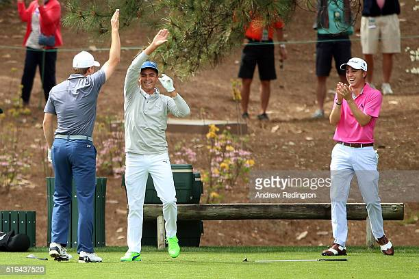 Rickie Fowler of the United States celebrates with Justin Thomas of the United States and Jordan Spieth of the United States after hitting a hole in...
