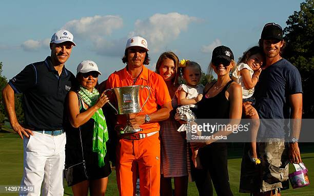 Rickie Fowler of the United States celebrates with the championship trophy alongside his mother Lynne Fowler girlfriend Alexandra Brown golfer Ben...