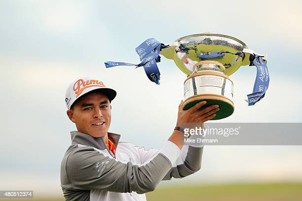 Rickie Fowler of the United States celebrates with the trophy during the trophy presentation after winning the Aberdeen Asset Management Scottish...