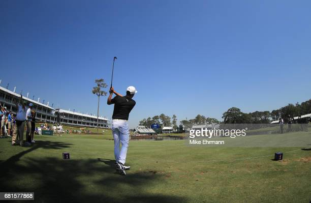 Rickie Fowler of the United States hits a hole in one on the 17th hole during a practice round prior to THE PLAYERS Championship at the Stadium...