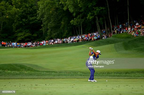 Rickie Fowler of the United States hits an approach on the sixth hole during the third round of the 96th PGA Championship at Valhalla Golf Club on...