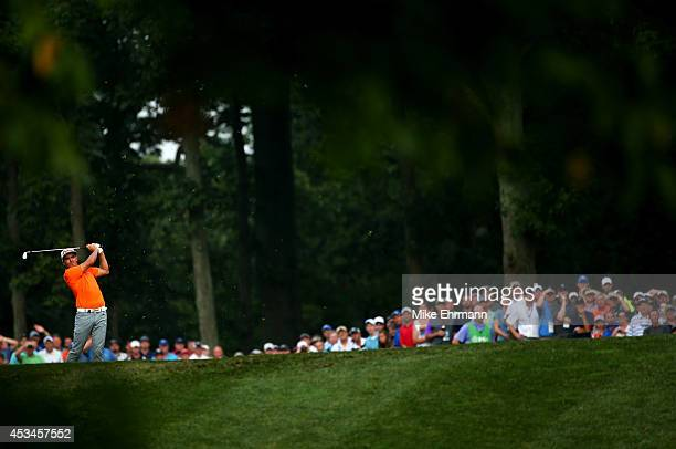 Rickie Fowler of the United States hits an approach shot on the 12th hole during the final round of the 96th PGA Championship at Valhalla Golf Club...
