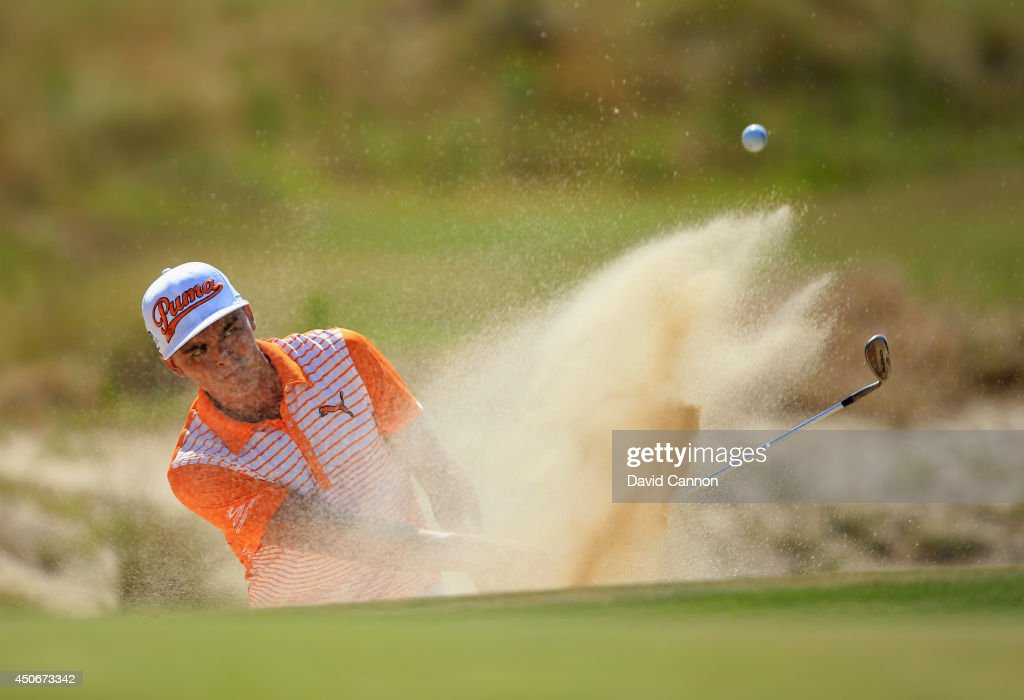 Rickie Fowler of the United States hits his second shot from a bunker on the third hole during the final round of the 114th U.S. Open at Pinehurst Resort & Country Club, Course No. 2 on June 15, 2014 in Pinehurst, North Carolina.