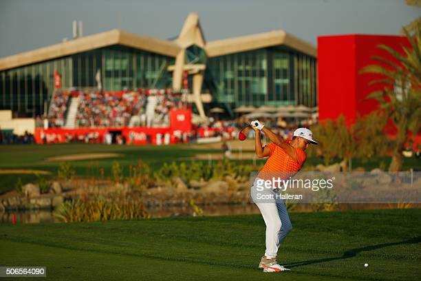 Rickie Fowler of the United States hits his second shot on the 18th hole during the final round of the Abu Dhabi HSBC Golf Championship at the Abu...