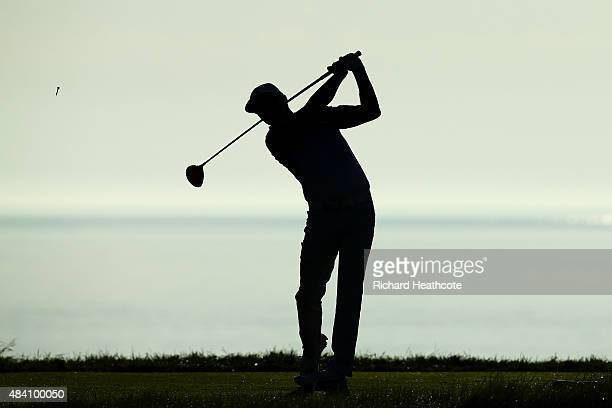 Rickie Fowler of the United States hits his tee shot on the 18th hole during the continuation of the weather-delayed second round of the 2015 PGA...