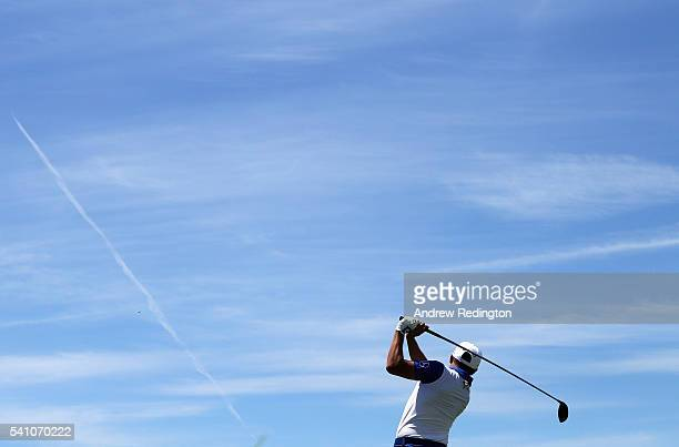 Rickie Fowler of the United States hits his tee shot on the ninth hole during the continuation of the second round of the US Open at Oakmont Country...