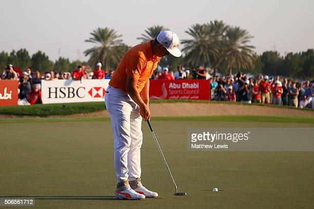 Rickie Fowler of the United States holes out on the 18th green to give him victory during round four of the Abu Dhabi HSBC Golf Championship at the...