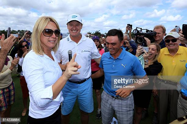 Rickie Fowler of the United States is congratulated by Ernie Els and his wife Liezl after he had just holed in one in the $1 million HoleInOne...