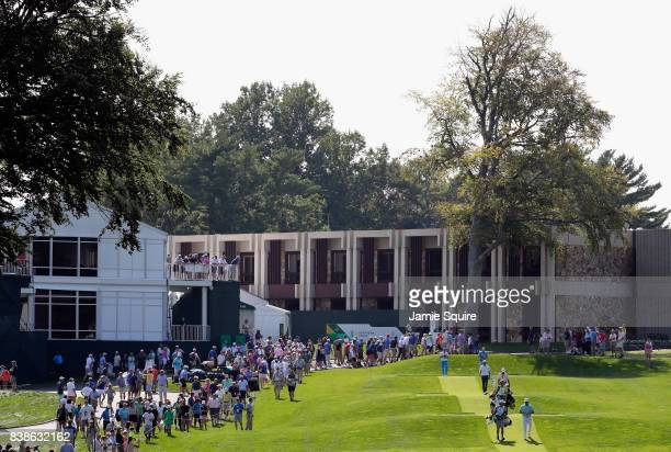 Rickie Fowler of the United States Jon Rahm of Spain and Dustin Johnson of the United States walk on the tenth hole during round one of The Northern...