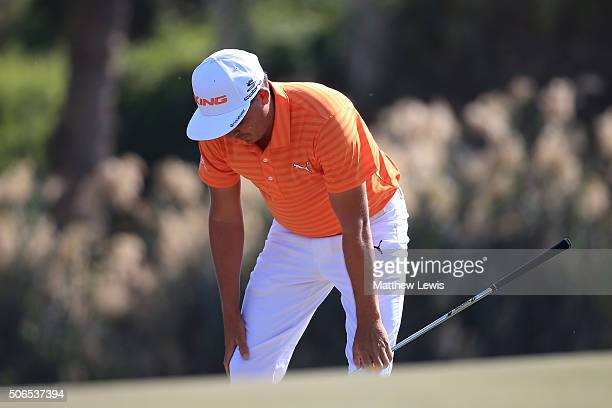 Rickie Fowler of the United States looks on after playing his second shot on the 7th hole during round four of the Abu Dhabi HSBC Golf Championship...