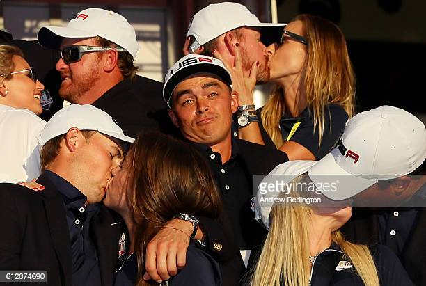 Rickie Fowler of the United States looks on as JB Holmes Erica Holmes Jimmy Walker Erin Walker Jordan Spieth Annie Verret Justine Reed and Patrick...