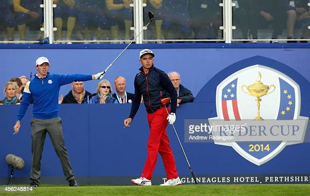 Rickie Fowler of the United States looks on as Rory McIlroy of Europe signals left after his tee shot on the 1st during the Singles Matches of the...