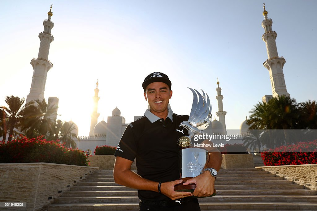 Rickie Fowler of the United States pictured with the Abu Dhabi HSBC Championship Trophy ahead of the Abu Dhabi HSBC Golf Championship at Sheikh Zayed Grand Mosque on January 17, 2017 in Abu Dhabi, United Arab Emirates.