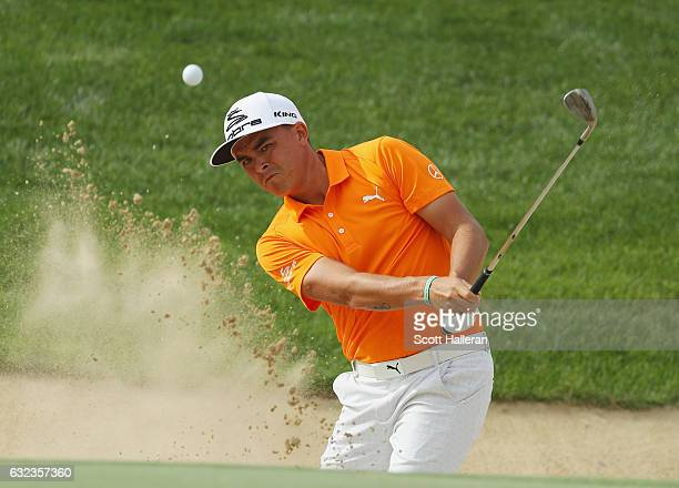 Rickie Fowler of the United States plays a bunker shot on the third hole during the final round of the Abu Dhabi HSBC Championship at Abu Dhabi Golf...