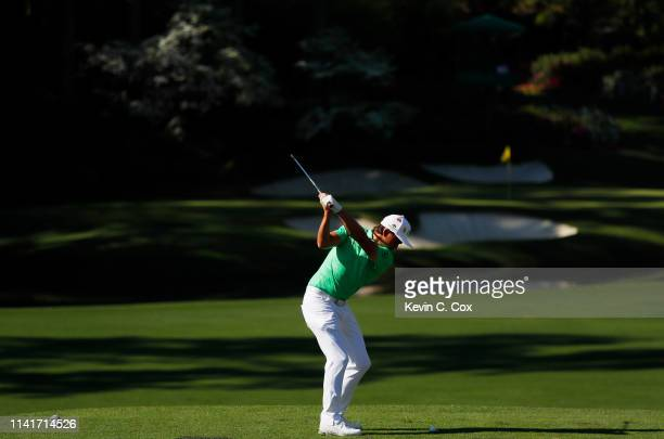 Rickie Fowler of the United States plays a shot during a practice round prior to the Masters at Augusta National Golf Club on April 10 2019 in...