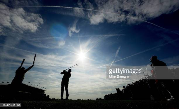 Rickie Fowler of the United States plays a shot during the morning fourball matches of the 2018 Ryder Cup at Le Golf National on September 28, 2018...