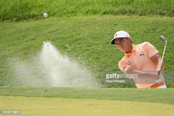 Rickie Fowler of the United States plays a shot from a bunker on the sixth hole during the final round of the 2018 PGA Championship at Bellerive...