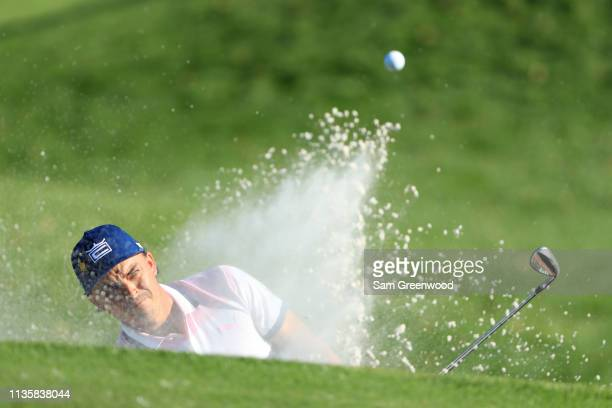 Rickie Fowler of the United States plays a shot from a bunker on the 12th hole during the first round of The PLAYERS Championship on The Stadium...