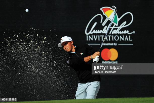 Rickie Fowler of the United States plays a shot from a bunker on the 17th hole during the second round of the Arnold Palmer Invitational Presented By...