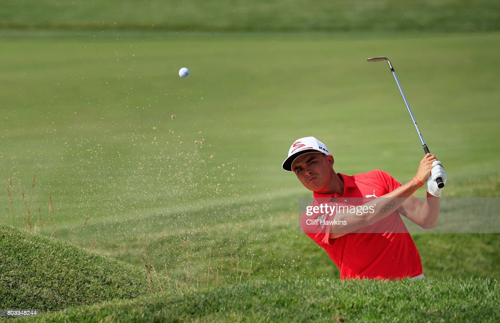 Rickie Fowler of the United States plays a shot from a bunker on the 14th hole during the first round of the Quicken Loans National on June 29, 2017 TPC Potomac in Potomac, Maryland.