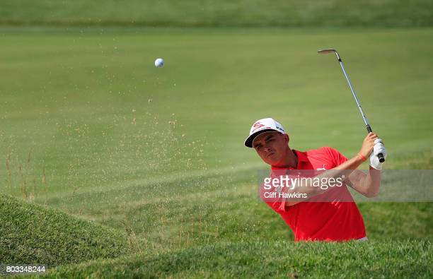 Rickie Fowler of the United States plays a shot from a bunker on the 14th hole during the first round of the Quicken Loans National on June 29 2017...