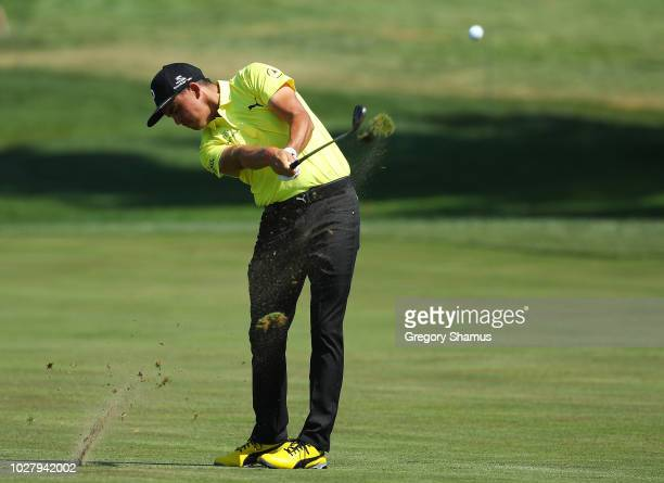 Rickie Fowler of the United States plays a shot on the 12th hole during the first round of the BMW Championship at Aronimink Golf Club on September...