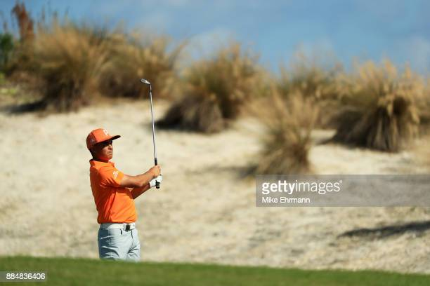 Rickie Fowler of the United States plays a shot on the fourth hole during the final round of the Hero World Challenge at Albany Bahamas on December 3...