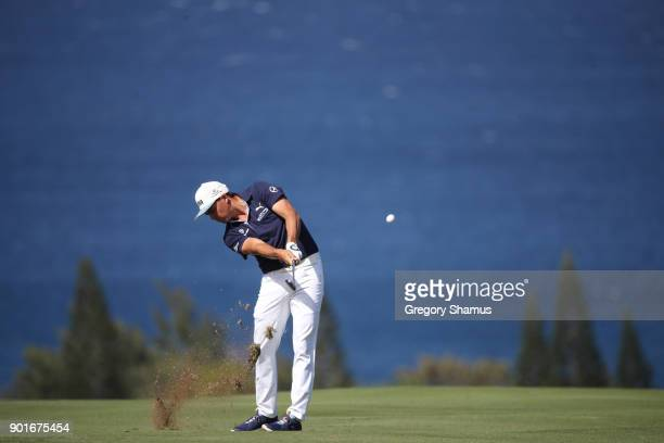 Rickie Fowler of the United States plays a shot on the fourth hole during the second round of the Sentry Tournament of Champions at Plantation Course...