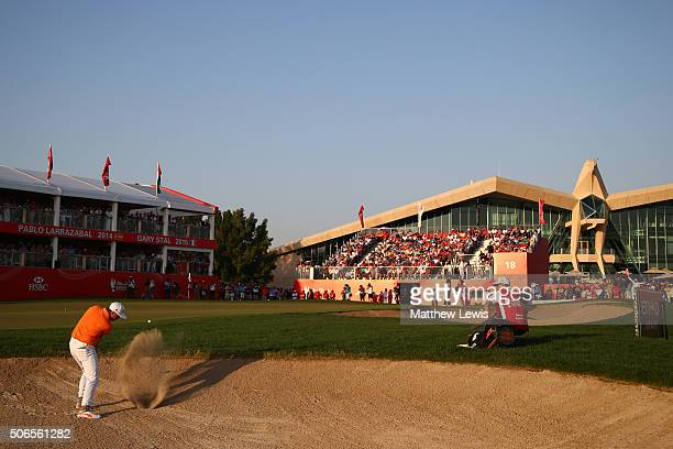 Rickie Fowler of the United States plays from a bunker on the 18th hole during round four of the Abu Dhabi HSBC Golf Championship at the Abu Dhabi...
