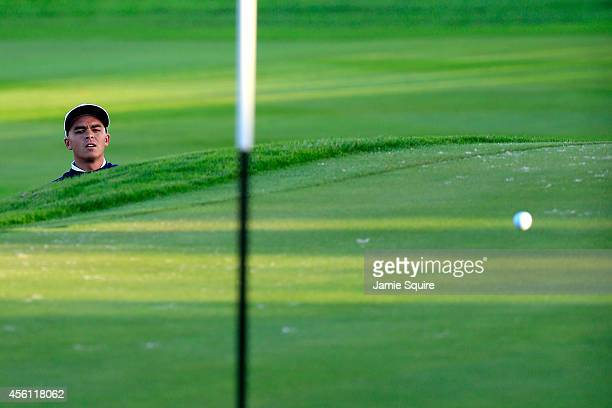 Rickie Fowler of the United States plays from a bunker on the 1st hole during the Morning Fourballs of the 2014 Ryder Cup on the PGA Centenary course...