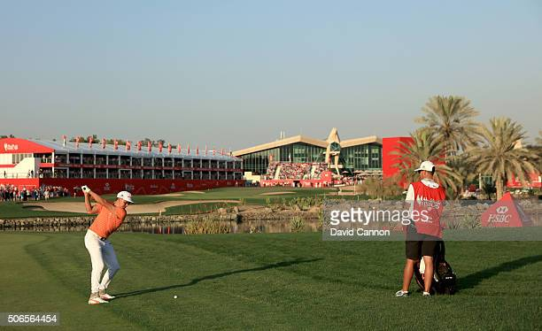 Rickie Fowler of the United States plays his second shot at the par 5 18th hole during the final round of the 2016 Abu Dhabi HSBC Golf Championship...