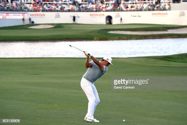 Rickie Fowler of the United States plays his second shot on the 16th hole during the first round of the 2018 Honda Classic on The Champions Course at...