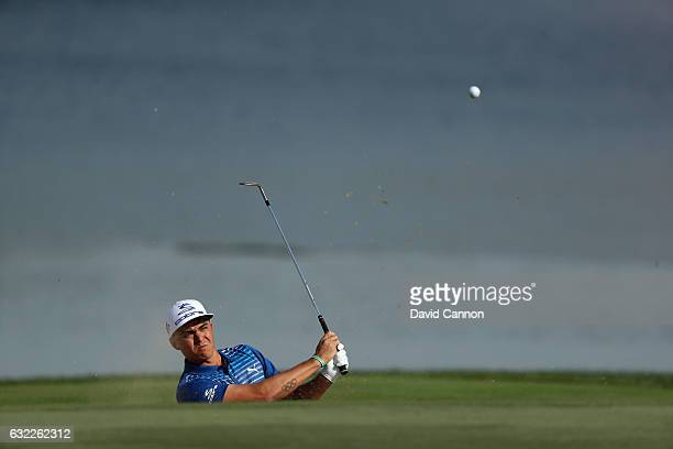 Rickie fowler of the United States plays his second shot on the fourth hole during the third round of the 2017 Abu Dhabi HSBC Golf Championship at...