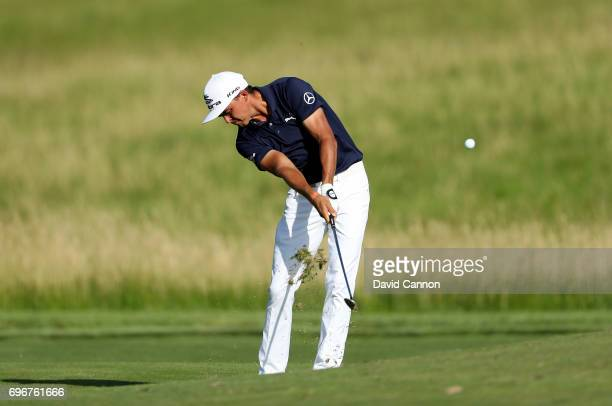 Rickie Fowler of the United States plays his second shot on the par 4, 15th hole during the second round of the 117th US Open Championship at Erin...