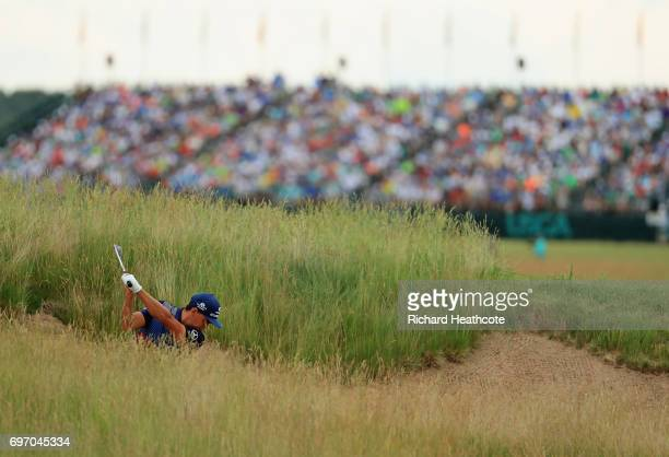 Rickie Fowler of the United States plays his shot from a bunker on the 18th hole during the third round of the 2017 US Open at Erin Hills on June 17...