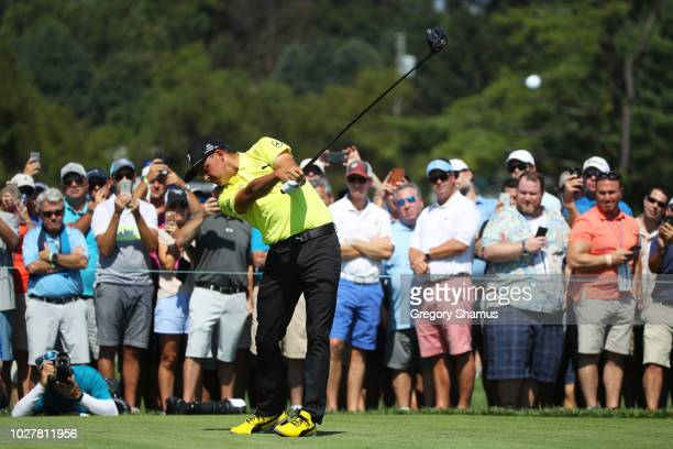 Rickie Fowler of the United States plays his shot from the 11th tee during the first round of the BMW Championship at Aronimink Golf Club on...