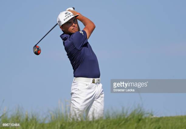 Rickie Fowler of the United States plays his shot from the 12th tee during the second round of the 2017 U.S. Open at Erin Hills on June 16, 2017 in...