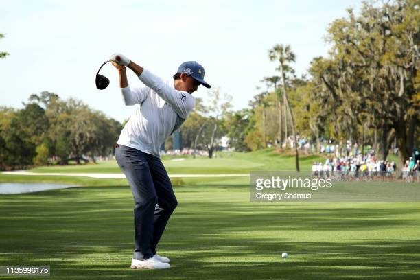 Rickie Fowler of the United States plays his shot from the 14th tee during the second round of The PLAYERS Championship on The Stadium Course at TPC...